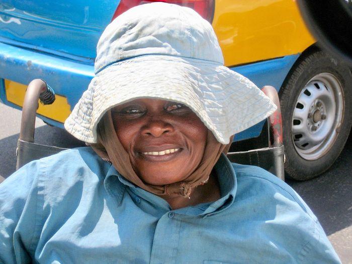 Portrait of a smiling beggar