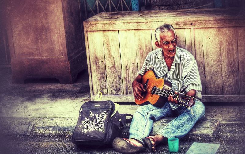 Street artist Musician Musical Instrument music brings us together Streetphotography Street Artist Old Man Malaysia Penang Island Sitting Men Senior Adult Wireless Technology Senior Men Retirement Beard Front View Full Length
