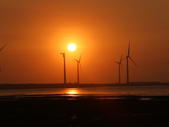 TakeoverContrast Fuel And Power Generation Wind Turbine Wind Power Windmill Sunset Water Ocean