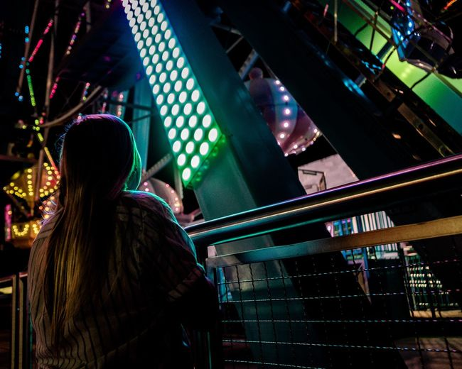 Carnival rides and lights Arts Culture And Entertainment Nightlife Night Real People Illuminated Music Leisure Activity Crowd Fun Adult Lighting Equipment Indoors  Lifestyles Group Of People Women People Enjoyment Men Event Rear View