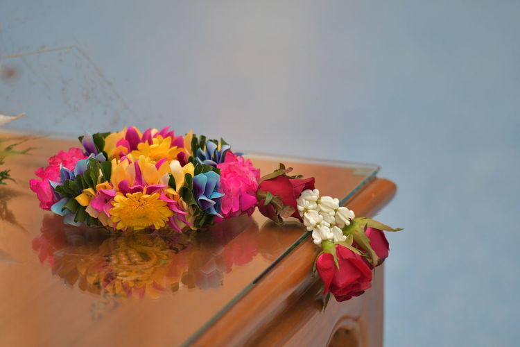 Close-up of multi colored flowers on table