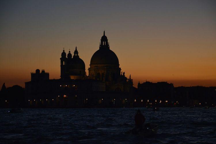 Silhouette saint mark basilica against sky during sunset