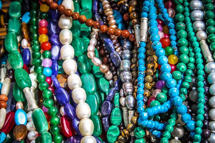 Close-up of multi colored jewelry for sale
