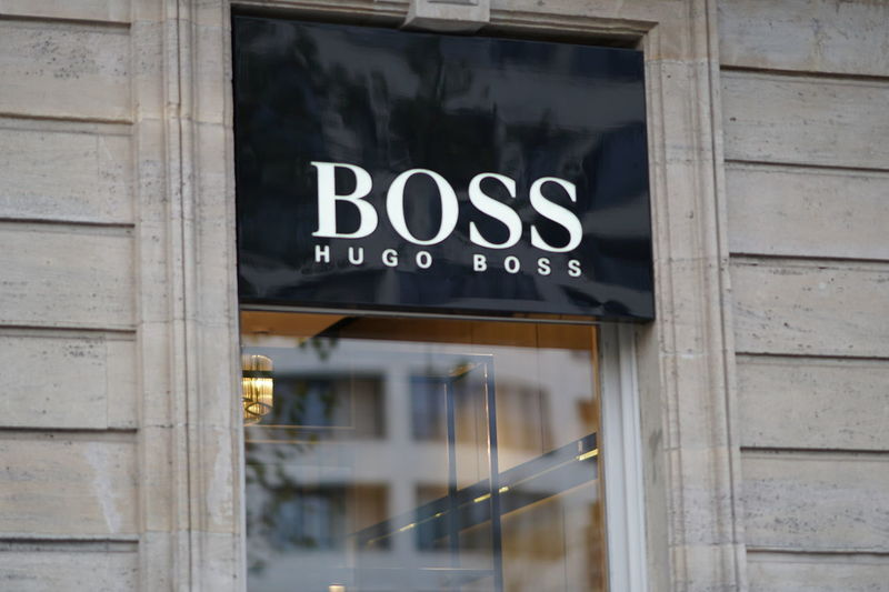 Bruxelles, Belgium - December 9, 2017: Hugo Boss logo outside a store. The company is a famous German fashion label founded by Hugo Boss in 1924 Boutique Clothes Store Fashion Stylish Brand Clothes Shop Clothes Shopping Clothing Shop Clothing Store Luxury Outlet Shopaholic Shopping Mall Style