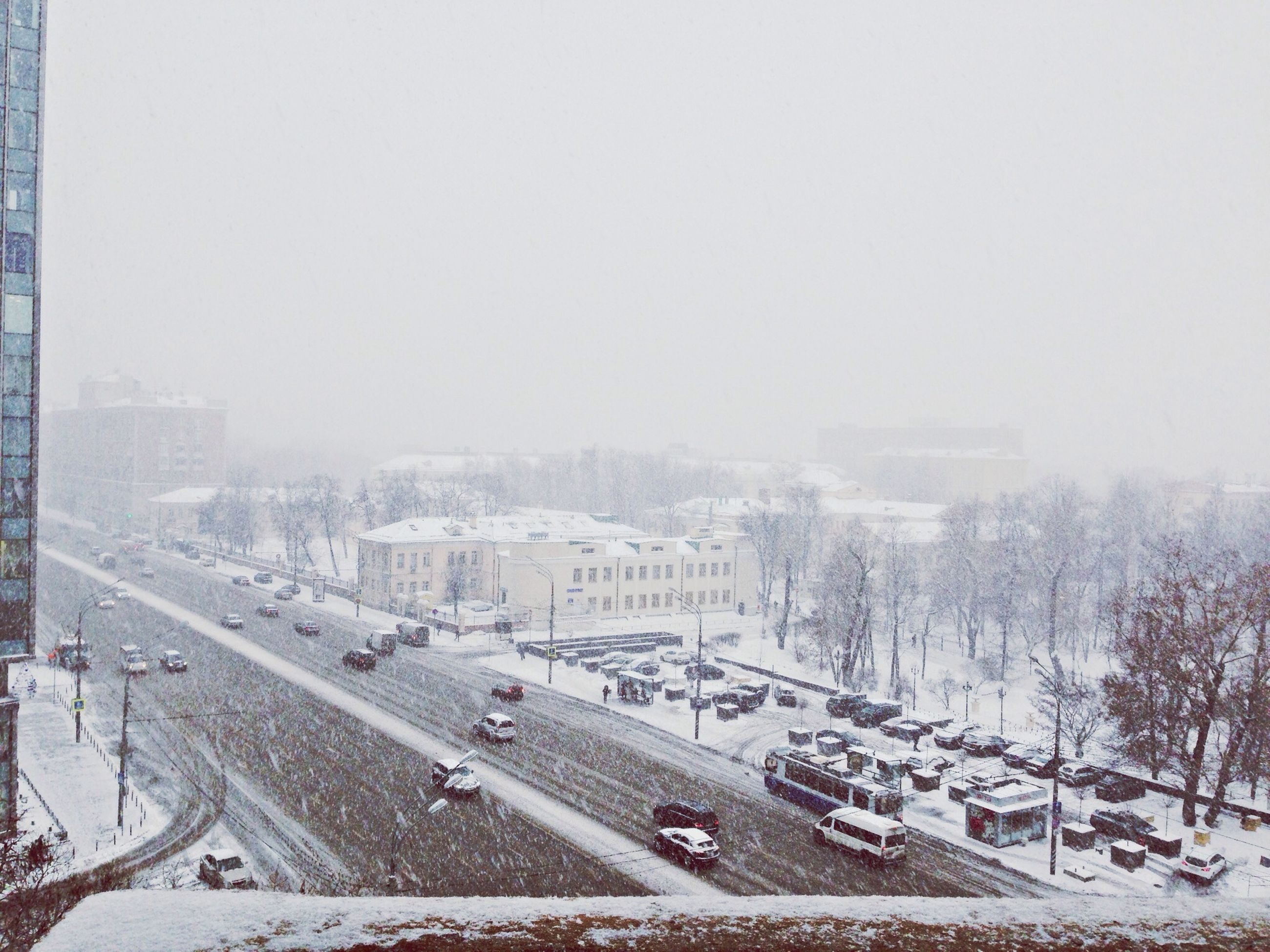 winter, snow, cold temperature, transportation, building exterior, season, architecture, clear sky, built structure, high angle view, weather, car, copy space, land vehicle, road, city, mode of transport, covering, street, tree