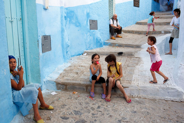 A street scene from the medina of the blue city of Chefchaouen, Morocco. Chefchaouen Children Daily Life Medina Morocco Street_photo_club Streetphotography Travel