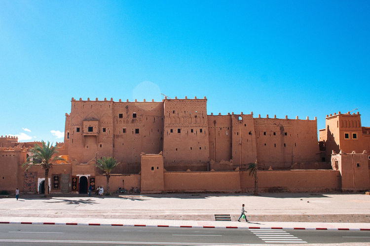 Ouarzazate Africa Architecture Blue Building Exterior Built Structure Clear Sky Copy Space Day History Large Group Of People Leisure Activity Lifestyles Maroc Marocco Men Outdoors People Real People Sky Sunlight Travel Destinations