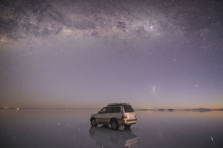 Car on land against sky at night