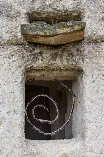 Architecture Art And Craft Building Building Exterior Built Structure Circle Close-up Concrete Day Geometric Shape Hole No People Old Outdoors Shape Solid Stone Material Stone Wall Wall Wall - Building Feature Weathered Window