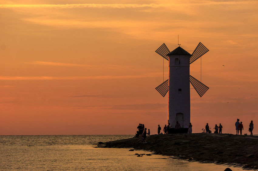 Romantic Landscape Silhouettes Stawa Mlyny Tranquility Architecture Beauty In Nature Building Exterior Built Structure Guidance Horizon Horizon Over Water Idyllic Lighthouse Nature Orange Color Outdoors Scenics - Nature Sea Sky Sunset Tower Travel Destinations Water