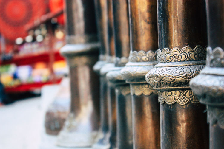 Close-up of religious bowls in temple