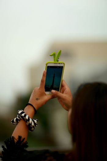 Cropped image of woman holding smart phone