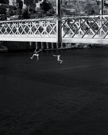 Porto Brige Jumping Man Adult People Water City Duoro River Travel Photography The Week On EyeEm Downtown District Travel Lifestyles Bridge - Man Made Structure Black & White Bnw_friday_eyeemchallenge Bnw_collection Black&white City River Collection Bnw_bridge Black And White Black And White Friday Be. Ready. An Eye For Travel
