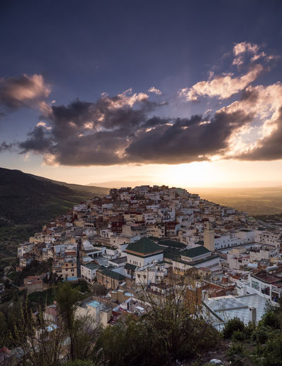 High angle shot of townscape against sky at sunset