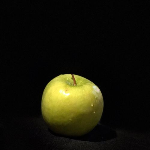 Wanna Apple 🍏? Fruit Healthy Eating Black Background Food Food And Drink Studio Shot Green Color Granny Smith Apple Close-up
