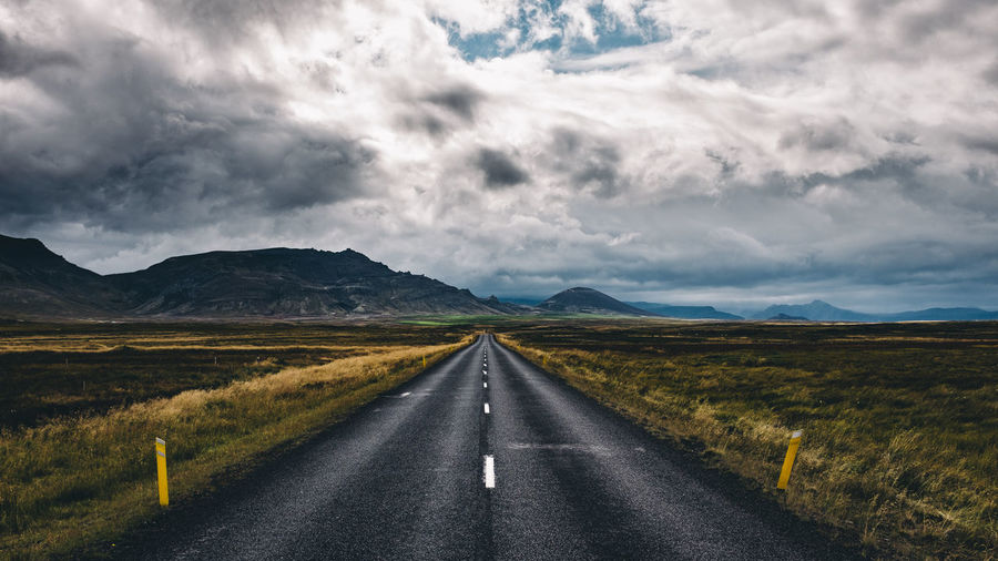 Somewhere in east Iceland Asphalt Close-up Cloud - Sky Day Futuristic Highway Iceland Landscape Mountain No People Outdoors Road Scenics The Way Forward Vacations Weather Winding Road