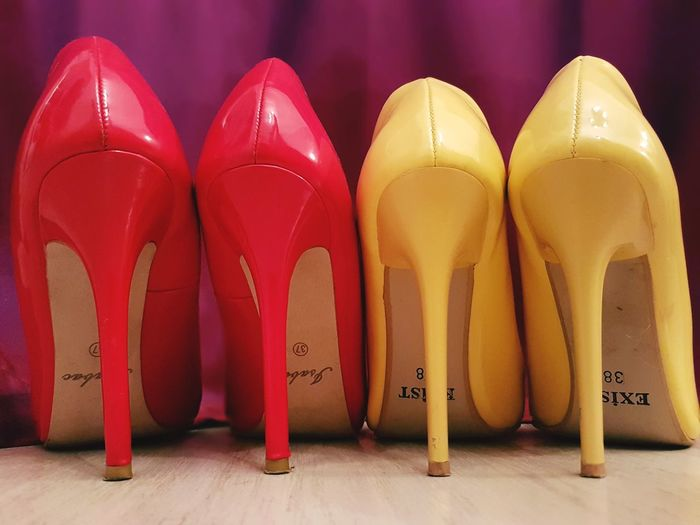 In A Row No People Studio Shot Yellow Close-up Hardwood Floor Indoors  Fashion&love&beauty Fashion 100 Shades Of Yellow Shoes High Heels Stilletos Yellow Stilletos Red Color Yellow Color Red Stilletos Heels Paint The Town Yellow Red And Yellow Vibrant Colors
