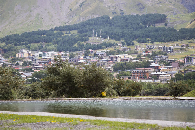 Scenic view of townscape by mountain