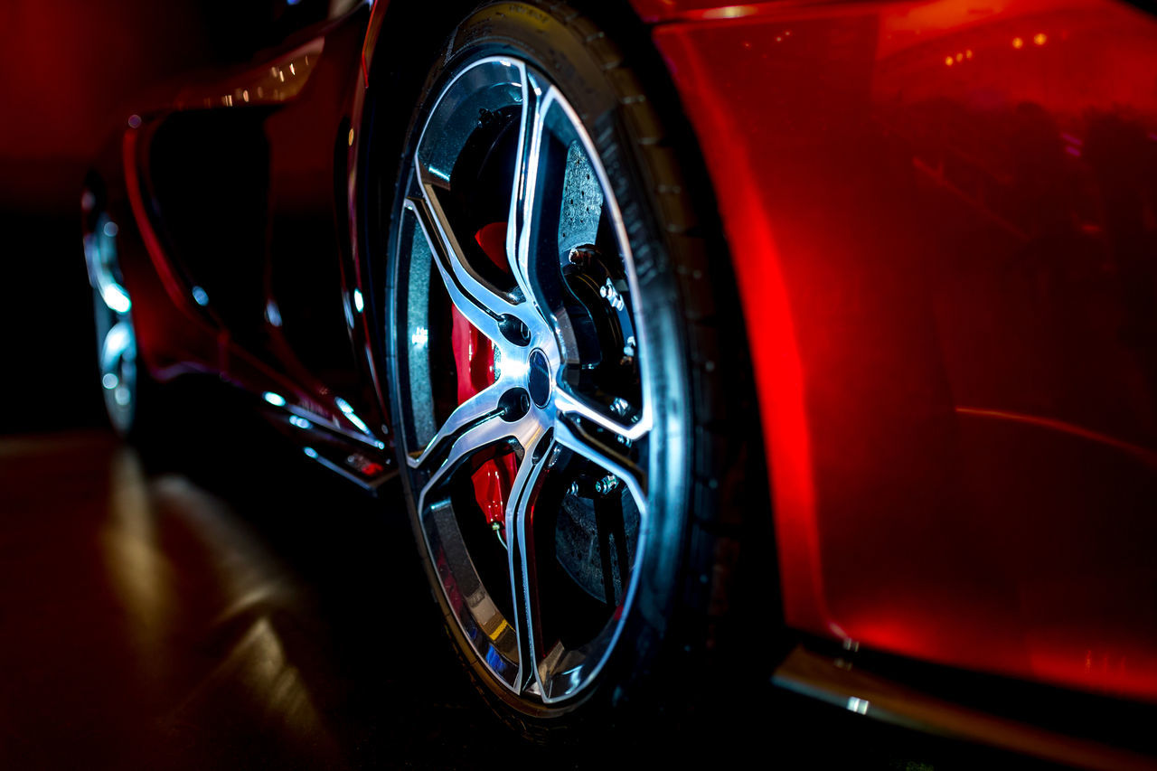 transportation, mode of transport, land vehicle, car, red, reflection, tire, wheel, stationary, shiny, no people, close-up, vehicle part, day, outdoors