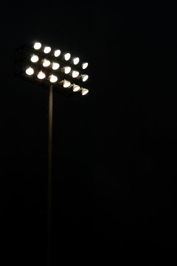 Stadium lights on a sports field at night with copy space Dark Football Friday Night Lights Lights Stadium Stadium Lights USA Night Sports