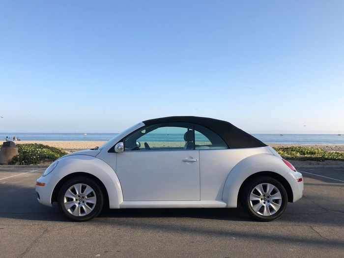 [Proud Papa] …presenting daughters new *first* car. Cabrio Convertible Beetle Transportation Car Sky Clear Sky Water Beach Travel