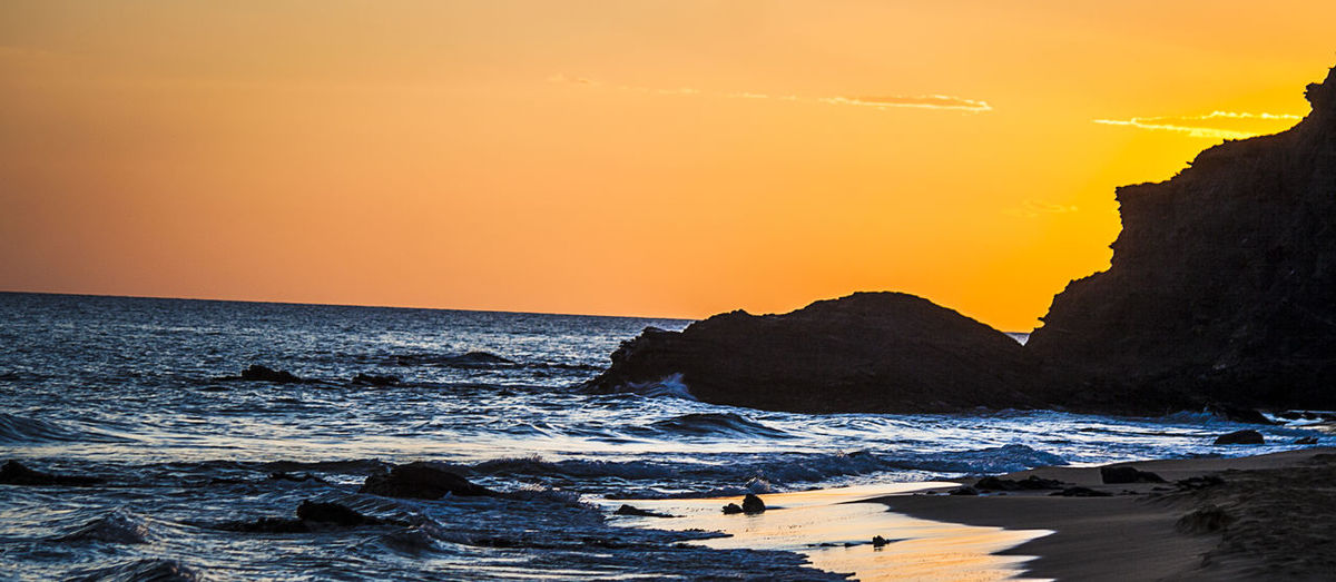 Calblanque Natural Park Calblanque Spain Cartagena Beach Beauty In Nature Calblanque Calblanquebeach Day Horizon Over Water Nature No People Orange Color Outdoors Rock - Object Scenics Sea Sky Sunset Tranquility Water Wave