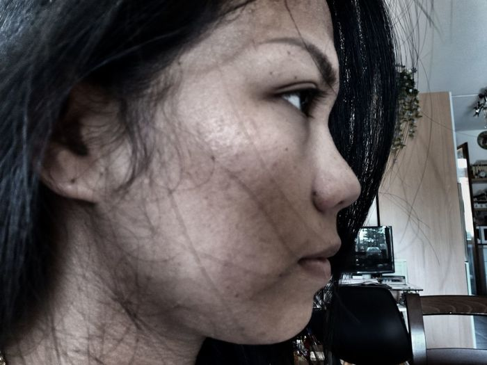 Close-Up Side View Of Woman At Home