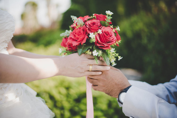 Bouquet Bride Celebration Couple - Relationship Event Flower Flower Arrangement Flowering Plant Hand Holding Human Body Part Human Hand Life Events Love Men Nature Newlywed Outdoors Plant Positive Emotion Togetherness Two People Wedding Wedding Ceremony