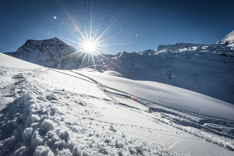 Winter Cold Temperature Snow Sky Beauty In Nature Sunlight Scenics - Nature Sun Snowcapped Mountain Mountain Nature Tranquility White Color Tranquil Scene Non-urban Scene Environment Covering Sunbeam Landscape Lens Flare Bright No People Extreme Weather