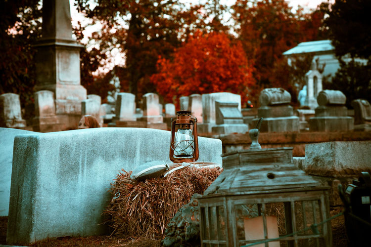 Halloween Lantern Architecture Built Structure Cemetery Day Fall Focus On Foreground Grave History Human Representation Lighting Equipment Nature Old Outdoors Plant Religion Representation The Past Tree