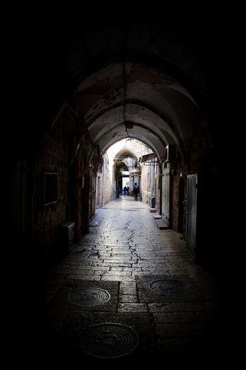 Narrow corridor along old building