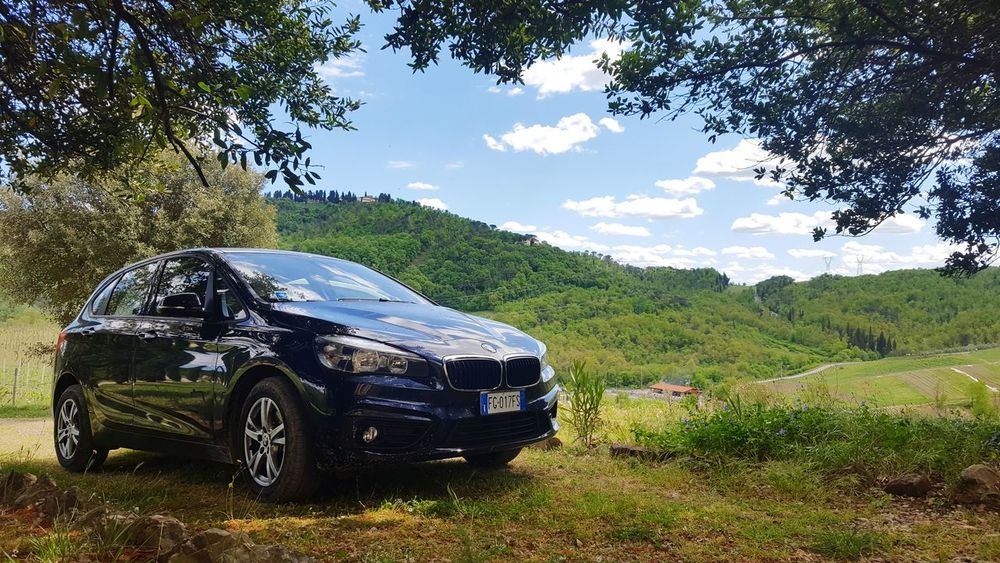 Bmw - our trusted ride around Italy. Car Nature Bmw Bmw2series Italy Mountains Italy Sky Italianlandscape Italy Tuscany No People Tree Day Outdoors Silhouette Mountains And Valleys Valley Sunrise Let's Go. Together. Your Ticket To Europe The Week On EyeEm Sonyrx100