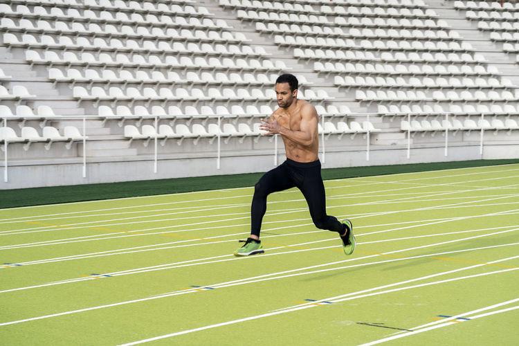Full length of man running at sports field