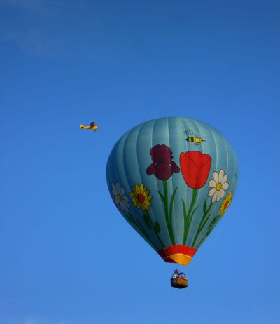 Adventure Balloon Blue Blue Sky Celebration Chance Colorful Culture Cultures Decoration Flowers Flying Hanging Hot Air Balloon Lantern Lucky Mid-air Multi Colored Plane Possibilities  Recreational Pursuit Red Relaxing Moments Tradition Yellow