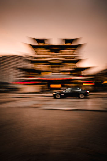 Car zooming pass Buddha Tooth Relic Temple ASIA Chinatown Chinatown, Singapore City City Life Motion Blur Singapore Speeding Architecture Blurred Motion Car City City Life Long Exposure Mode Of Transportation Motion Motor Vehicle No People Speed Street Temple Temple Architecture Transportation Travel Travel Destinations The Street Photographer - 2018 EyeEm Awards The Traveler - 2018 EyeEm Awards The Architect - 2018 EyeEm Awards The Creative - 2018 EyeEm Awards EyeEmNewHere