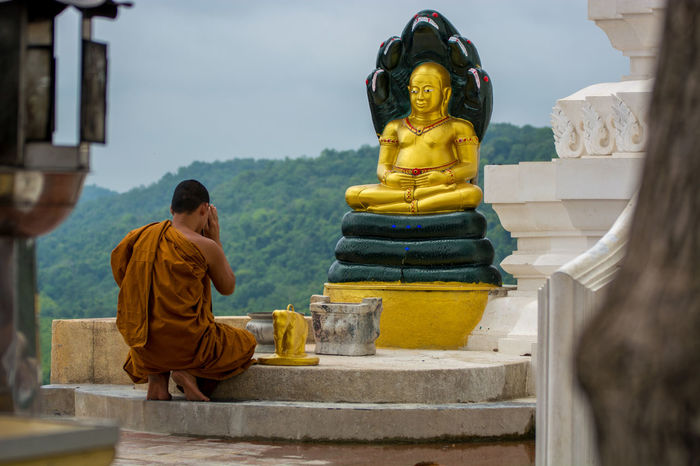 Buddha Buddhist Day Focus On Foreground Gold Leisure Activity Lifestyles Monk  Outdoors Praying For World Peace Temple Temple - Building Thailand Tourism Travel Destinations Worship