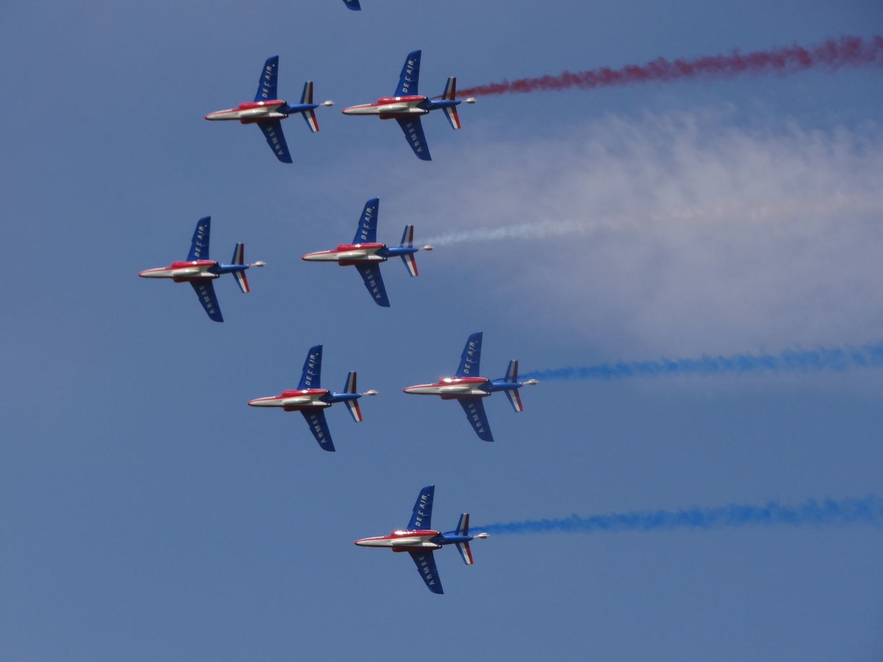 airplane, airshow, teamwork, transportation, flying, low angle view, vapor trail, sky, arrangement, mode of transport, air vehicle, on the move, smoke - physical structure, speed, fighter plane, blue, travel, accuracy, day, no people, military airplane, outdoors, formation flying, motion, propeller airplane, cooperation, cloud - sky, mid-air, air force, acrobatic activity, multi colored, aerobatics, nature