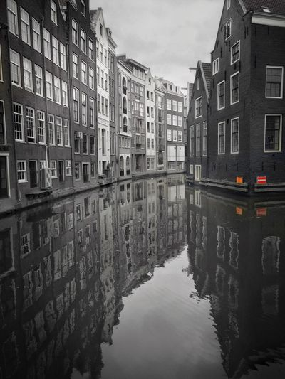 Amsterdam Canal Cityscapes Amsterdamcity IPhoneography Architecture Built Structure Side By Side Day City Life Building Exterior Water Reflections Netherlands Your Amsterdam