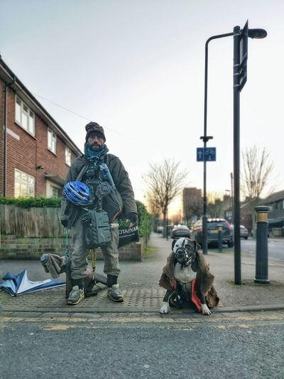 Man with dog on street in city