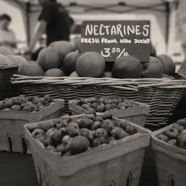 Fresh nectarines for sale at the Montauk Farmer's Market. Farmers Market Nectarines Abundance Arrangement Basket Black And White Black And White Photography Blackandwhite Blueberries Close-up Food Food And Drink Freshness Fruit Healthy Eating Large Group Of Objects Market Market Stall Montauk Selective Focus Small Business