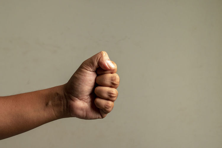 Close-up of person hand against white background