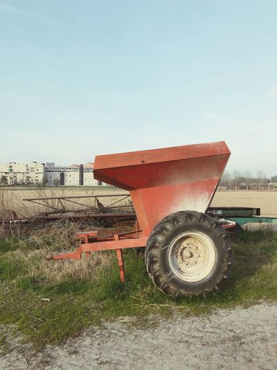 Transportation Field No People Clear Sky Day Land Vehicle Outdoors Agricultural Machinery Grass Architecture Tire Nature Sky Tractor Countryside Coutrylife Colors