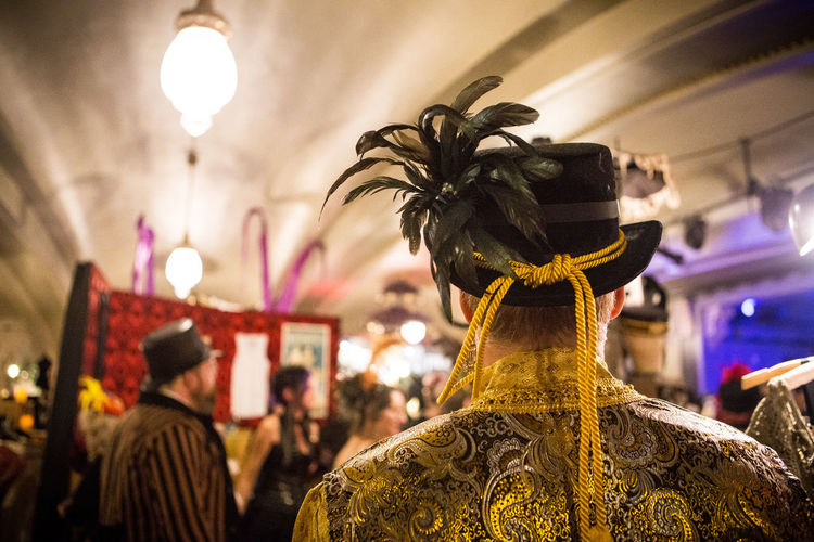 Art And Craft Arts Culture And Entertainment Back View Colorful Costume Cultures Detail Feature Hat Festival Focus On Foreground Man Mardi Gras Period Clothing Selective Focus Top Hat Traditional Clothing Creativity Art Portrait Head And Shoulders Edwardian Ball Fashion Feather Hat Original Experiences
