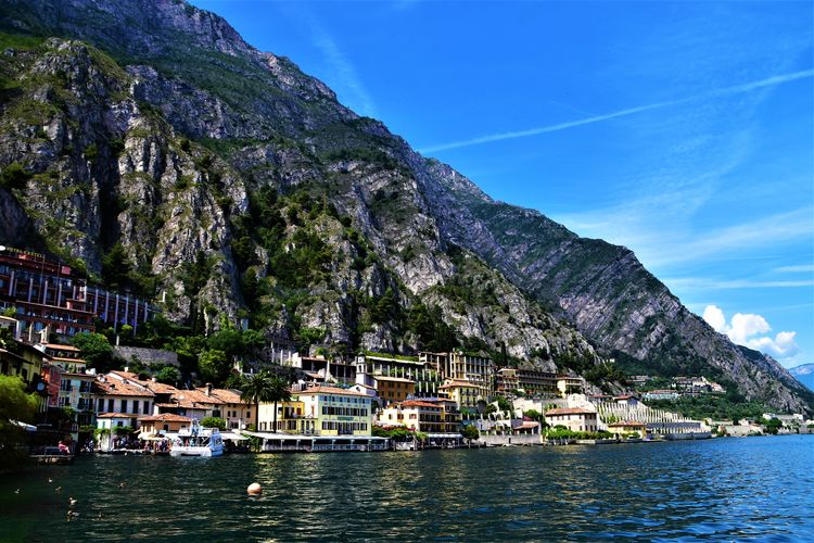 Gardasee Architecture Beauty In Nature Building Building Exterior Built Structure Garda Lake Italy Laandscape Mode Of Transportation Moored Mountain Mountain Range Nature Nautical Vessel Outdoors Sailboat Sea Sky Transportation Water Waterfront