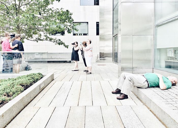 Adult Architecture Bad Back Painfull Building Exterior Built Structure Casual Clothing Celebration Day Full Length Graduation Ground Lifestyles Lying Down Men Outdoors People Real People Togetherness Tree Women Young Adult Young Women The Street Photographer - 2017 EyeEm Awards