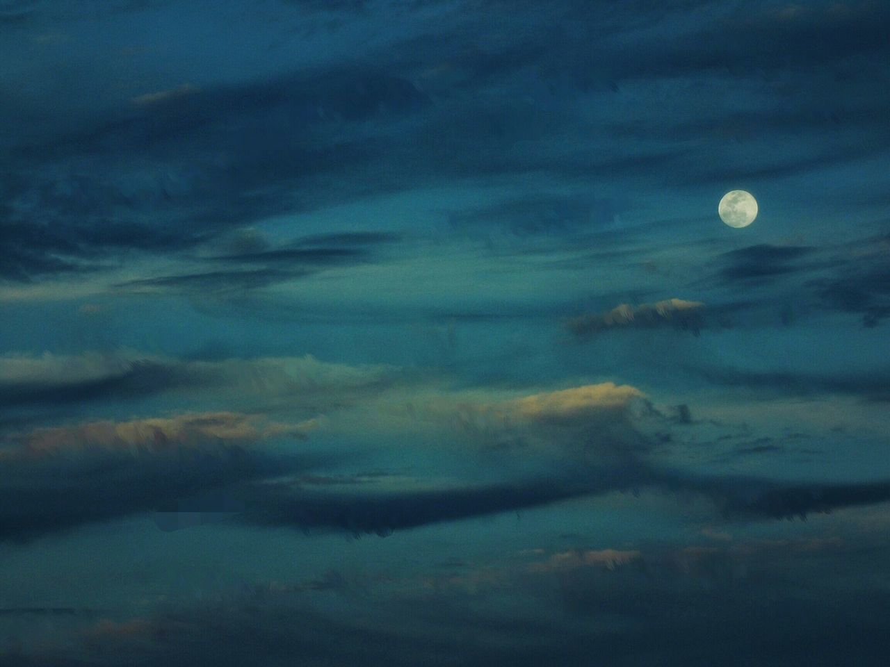 Low Angle View Of Full Moon In Sky At Night