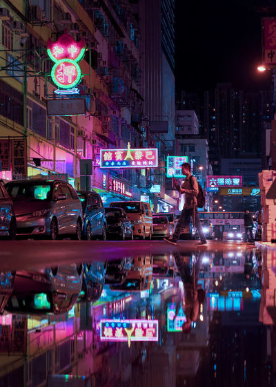 One Person Nightlife Outdoors Three Quarter Length Sign Adult Women People Car Motor Vehicle Real People Mode Of Transportation Transportation Built Structure Communication Street City Life Architecture Building Exterior Illuminated City Night EyeEm Selects EyeEm Gallery EyeEm Best Shots Tsuen Wan Cyberpunk Bladerunner Neon Sign Neon Colored Neon Lights Reflection Mirror Reflection Water Reflections