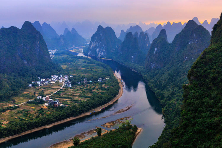 Yangshuo Sunrise Aerial View Agriculture Beauty In Nature China Guilin High Angle View Landscape Lush - Description Mountain Mountain Range Nature No People River Scenics Tranquility Travel Destinations Vacations Village