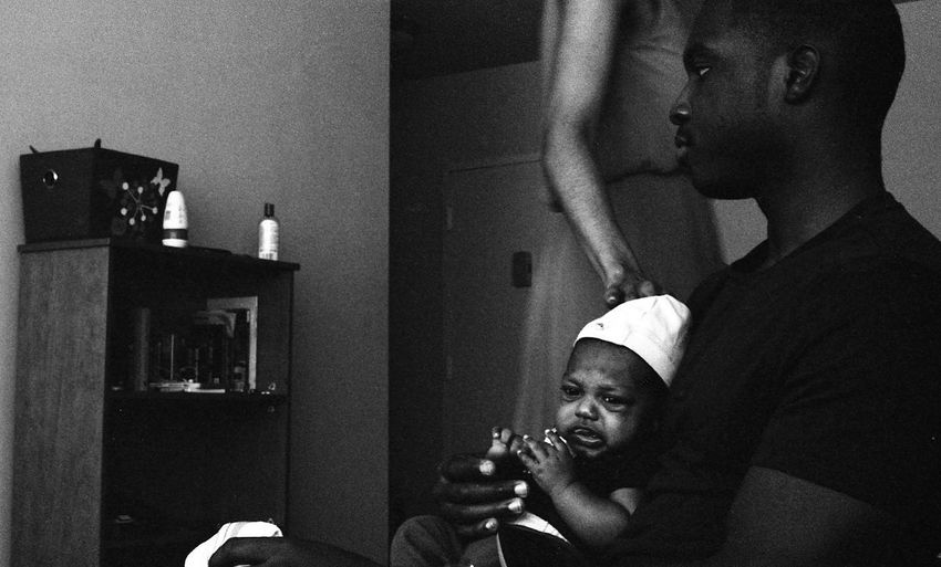 Photo by Kesi J. Marcus Blackandwhite Bonding Boys Childhood Close-up Day Film Photography Holding Home Interior Human Hand Indoors  Leisure Activity Lifestyles Men Mid Adult Men Mirror NewBorn Photography People Real People Togetherness Two People Young Adult Young Men Young Women