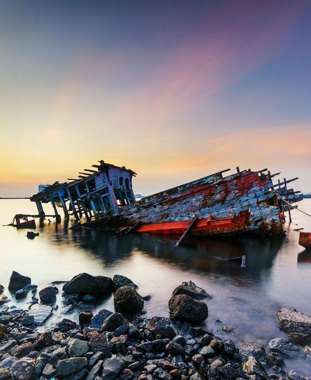 Sunset Beach Sea Sky No People Architecture Outdoors Water Building Exterior Night Landscape INDONESIA Landscape_photography Horizon Over Water Longexposure Long Exposure Beauty In Nature